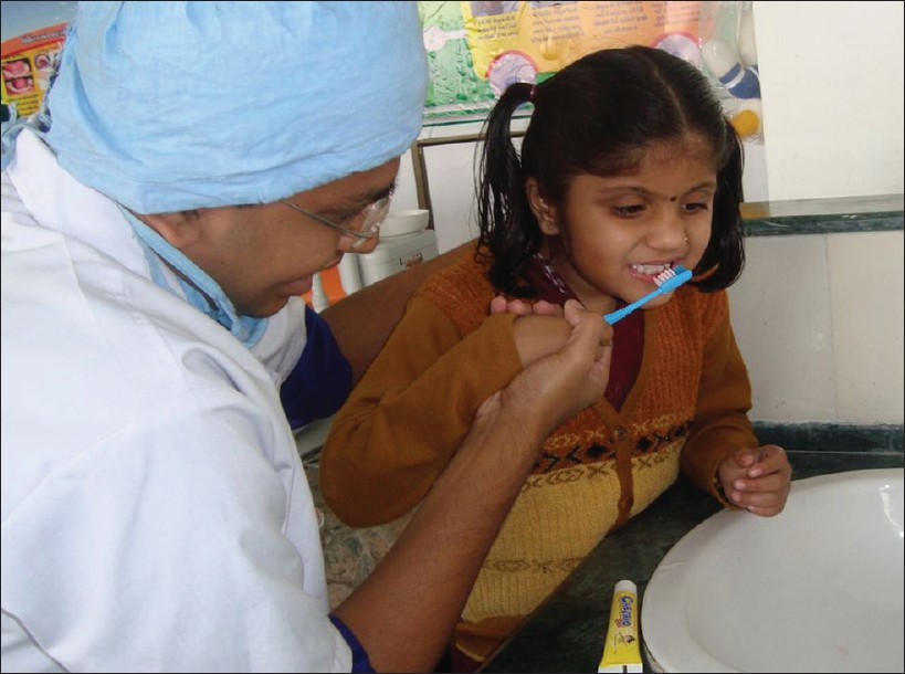 Figure 3: Child brushing with Colgate Smile