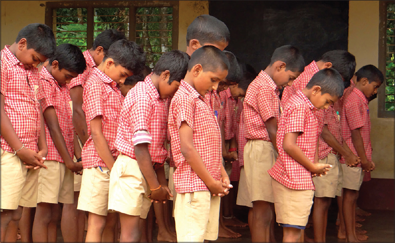 "Figure 2: Children demonstrating ""being a tree"" during the practice session at school"